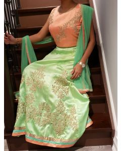 Indo Western Stitched Peach Choli with Green Lehenga for an Indian Wedding