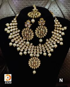 Gold Plated  Three piece Kundan Necklace Set With Pearls