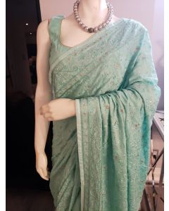 Turquoise Satin Saree having self Coloured Thread Embroidery with Stitched Blouse