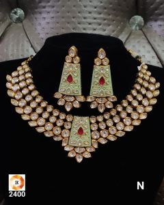 Gold plated  Three piece Kundan Necklace Set with Green Mina work