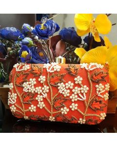 Orange hand embroidered party clutch