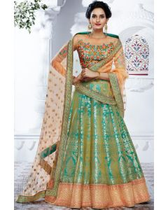 Indian heavy Party Wear Green Banarasi Lehenga with Multi color Thread Embroidered Crop top and Peach Net Dupatta